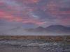 abziehender Sandsturm bei Sonnenuntergang